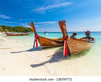 fisherman boat float in blue sea with white sand beach and beautiful sky.Lipe island.