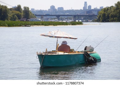 Fisherman in a boat on a city background