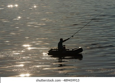 Fisherman in a boat on the lake.