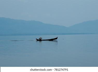 Fisherman boat on lake in Myanmar