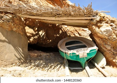 Fisherman boat under the shadow local tradition beautiful scenery old bay on the rocks shelter under the bright sun Ibiza island