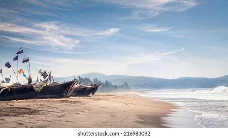 Fisherman boats on the Gokarna beach near the ocean in Karnataka, India
