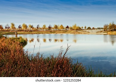 A fisherman by a little lake at Serris, France. The autumn has come and the nature is in it's brightest colors.