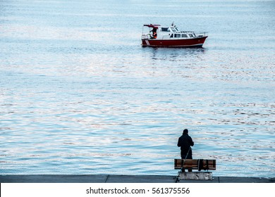 Fisherman by the sea fishing boat in the waters of the sea