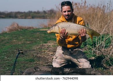 Fisherman with a carp