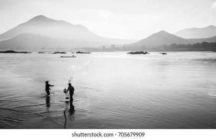 FisherMan cast a net at Kaeng Kud Ku, Mae Khong river, Chiang Khan, Loei, Thailand