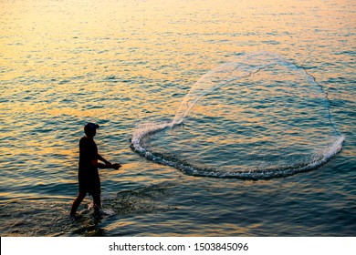 The fisherman cast a net the sea in the morning, at sunrise
