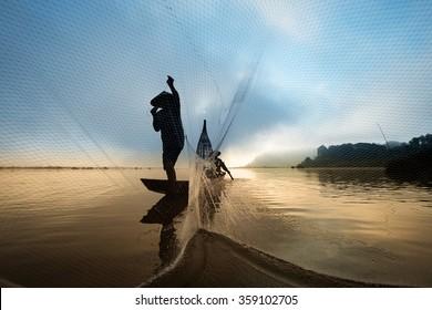Fisherman casting his net at Mae Klong River, Thailand