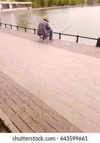 Fisherman catches fish in the city pond.