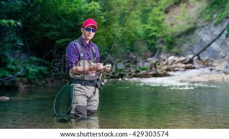 Fisherman Chooses Bait Trout Fishing River Stock Photo (Edit Now