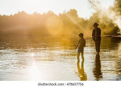 Fisherman in a cowboy hat with his son