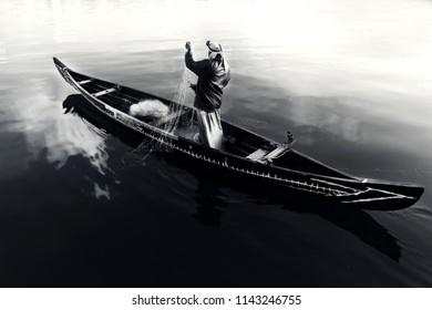 Fisherman fishing in boat