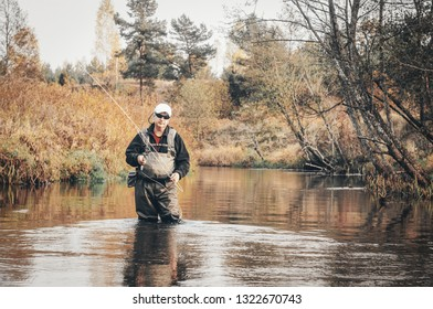 A fisherman fishing with fly fishing.