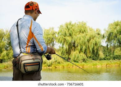 the fisherman is fishing on the lake