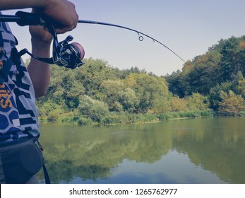 the fisherman is fishing on the lake in summer
