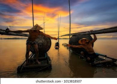Fisherman fishing at sunset.