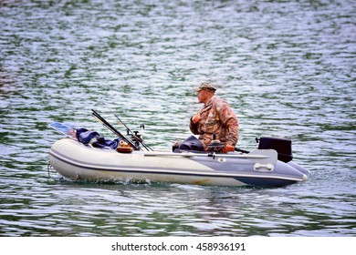 fisherman floats on an inflatable boat on a fishing trip