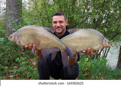 fisherman holding common breams
