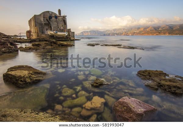 Fisherman house in the sea with long exsposure. Porto Paglia, Gonnesa, Sardinia