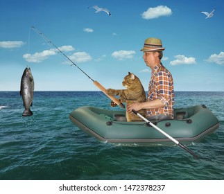 The fisherman im a straw hat with his cat is fishing in the rubber boat in the sea. They caught a big fish.