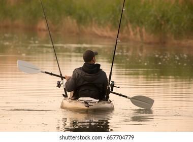 Fisherman in inflatable canoe.