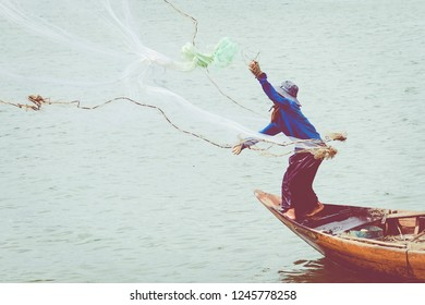 Fisherman of lake in action when fishing.