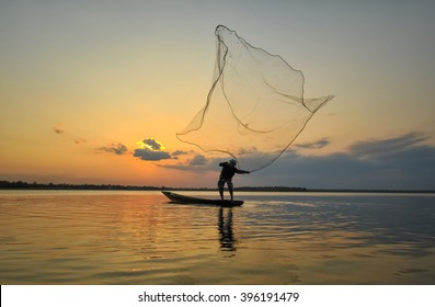Fisherman of lake in action when fishing on twilight