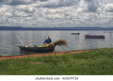 Fisherman leaving the river bank in Paraguay