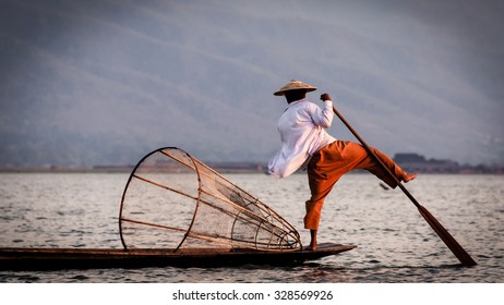 Fisherman leg rowing on the Inle Lake in Myanmar Burma