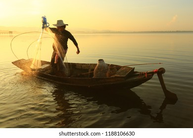 fisherman life and activities on boat in the morning at Bangpra reservoir, Chonburi , Thailand