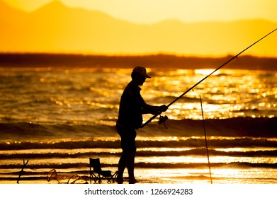 fisherman in light sunset