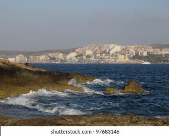 A fisherman long the coastline in Malta