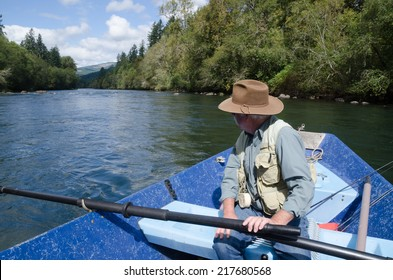 A fisherman looks down the Mckenzie River from his drift boat near Eugene Oregon.