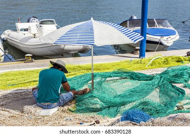 Fisherman mending nets in Port d'Andratx, Majorca, Balearic Islands, Spain, Europe