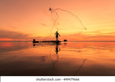 Fisherman with net in action ,Thailand