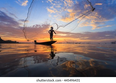 Fisherman with net in action,Thailand