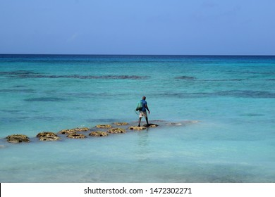 A fisherman with a net in the Caribbean Sea