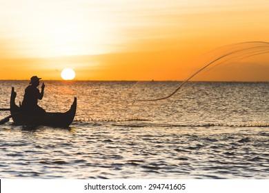 Fisherman with net in Jimbaran, Indonesia
