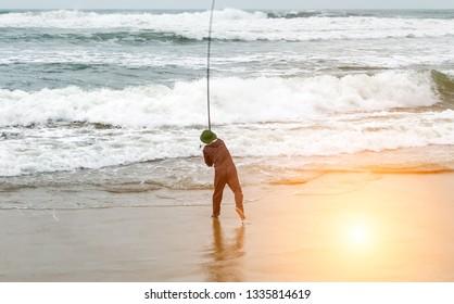 Fisherman in ocean fishing rod trolling in saltwater. Big game fishing.