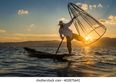 Fisherman with old culture style during sunset at Inle lake Myanmar