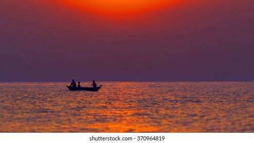 Fisherman on the boat in lake Combodia lake.