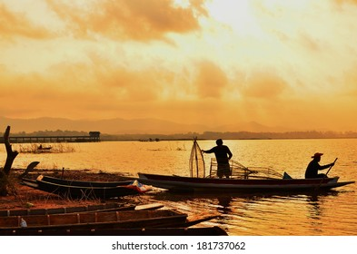 Fisherman on Boat at Sunrise Lake
