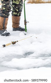 A fisherman on the ice with equipment for winter fishing