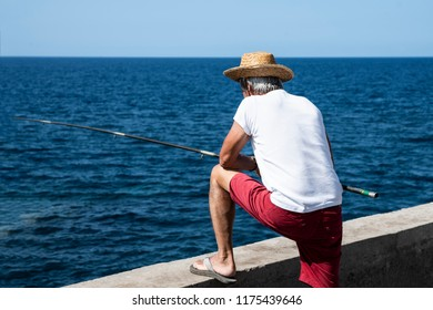 Fisherman on the oceanfront.
