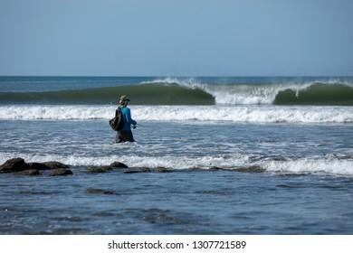 Fisherman on the shore of beach in Mariato, Panama