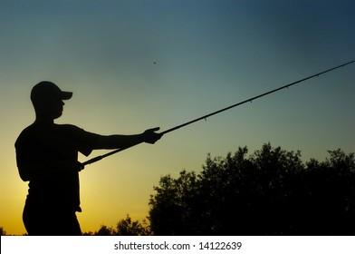 fisherman on sundown