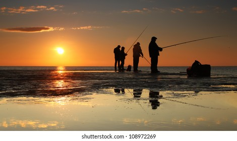Fisherman on sunrise on the pier