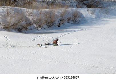 The fisherman on winter fishing fishes