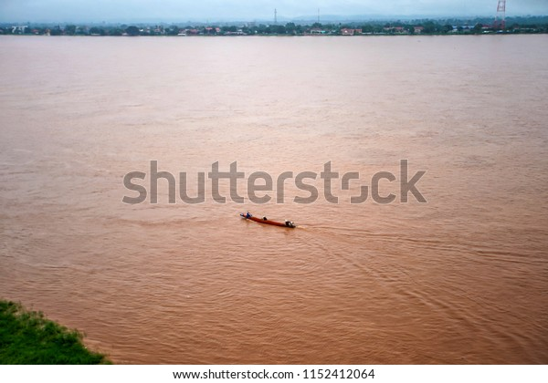 Fisherman out fishing boat in Mekong river, Nakornphanom Thailand and Laos