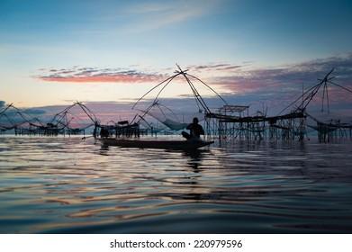 Fisherman of Pakpra Lake in action when fishing, Thailand